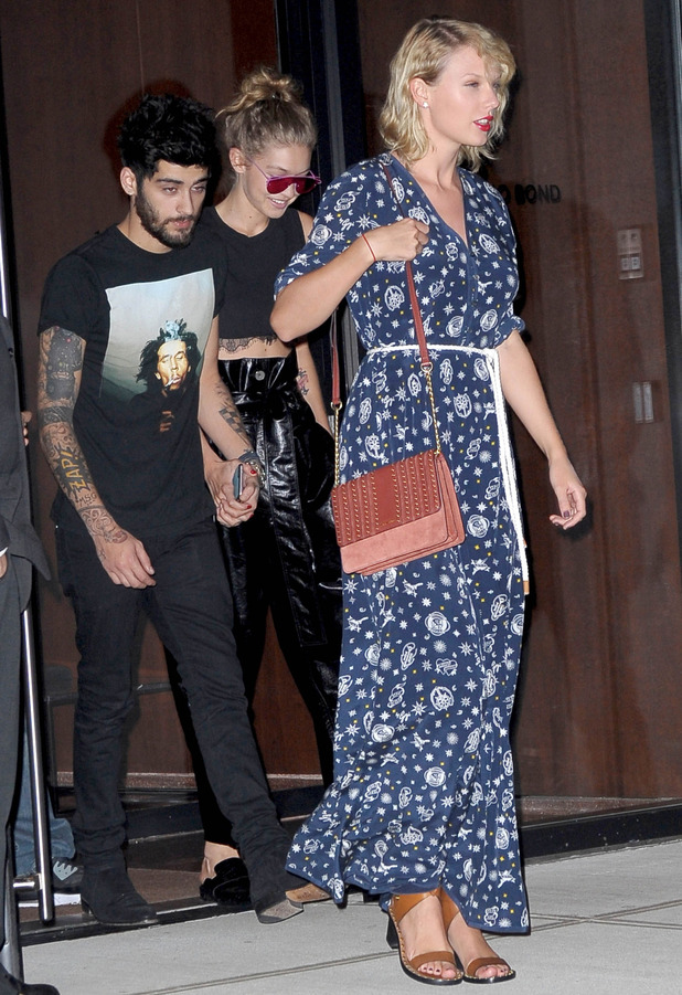 Singer Taylor Swift walks alongside model Gigi Hadid and ex-One Direction star Zayn Malik in New York 12 September 2016