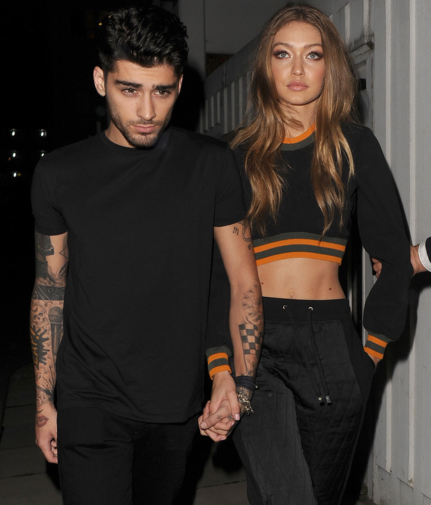Zayn Malik and Gigi Hadid leaving the Versace Versus show 17 September
