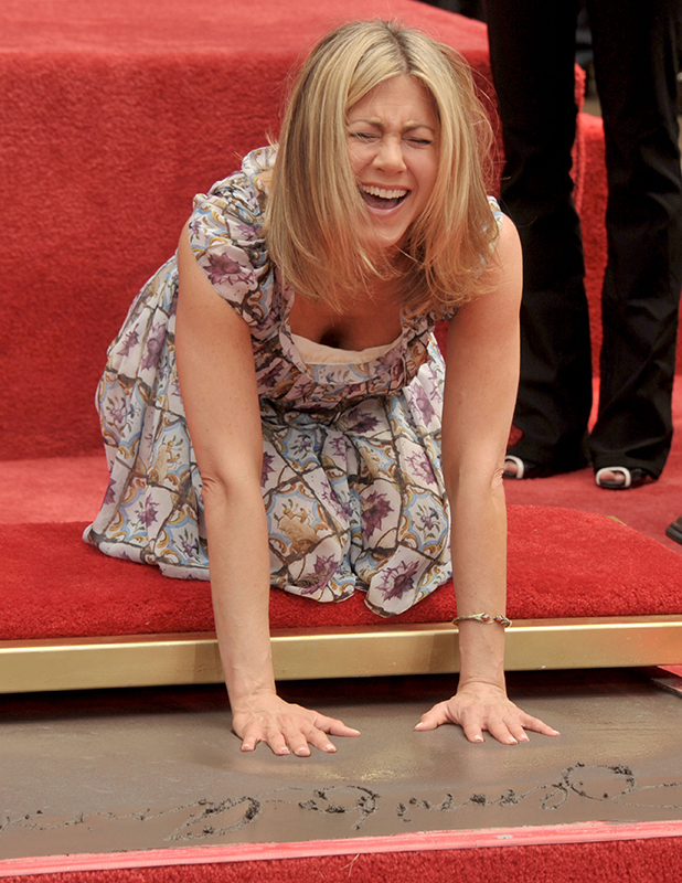 Jennifer Aniston poses at her Hand & Footprint Ceremony at the Grauman's Chinese Theatre on July 7, 2011 in Hollywood, California. (Photo by Gregg DeGuire/FilmMagic)