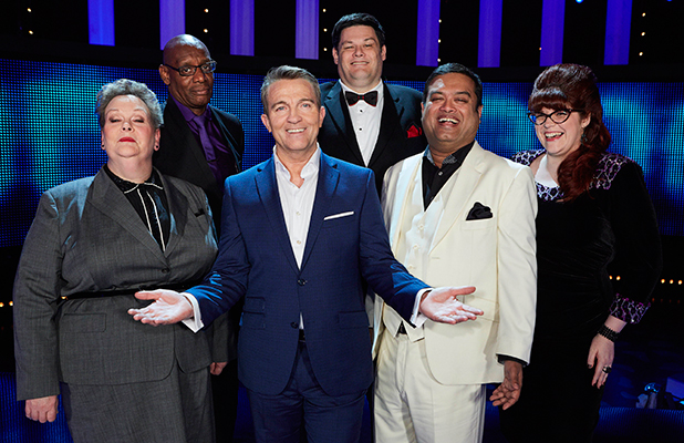 Host Bradley Walsh (centre) joins all The Chasers (l-r) Anne œThe GovernessHegerty, Shaun ˜The Barrister' Wallace, Mark ˜The Beast' Labbett, Paul ˜'The Sinnerman'' Sinha and Jenny ˜The Vixen' Ryan on set during the recording of the 1000th episode of The Chase.