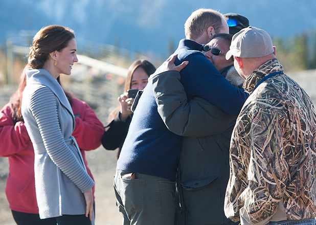 Prince William, Duke of Cambridge is hugged by a local as Catherine, Duchess of Cambridge looks at Montana mountain in Carcross on September 28, 2016 in Whitehorse, Canada. (Photo by Samir Hussein/WireImage)