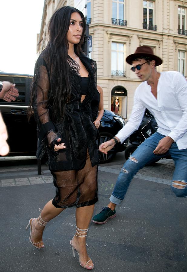Vitalii Sediuk jumps on Kim Kardashian West as she arrives at 'L'Avenue' restaurant on September 28, 2016 in Paris, France. (Photo by Marc Piasecki/GC Images)