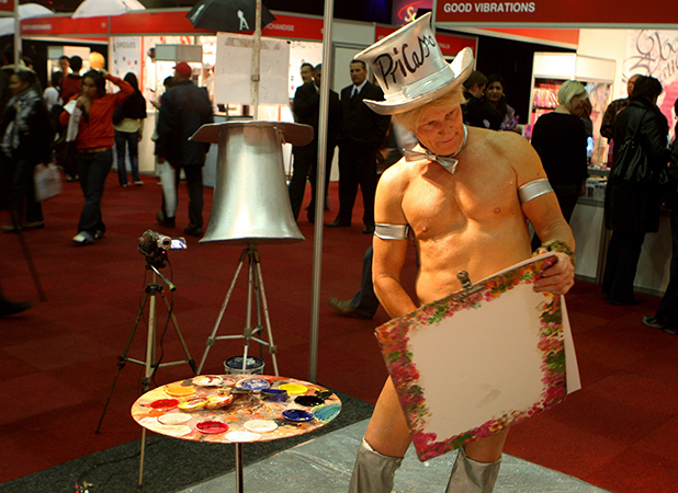 Artist Pricasso is busy creating an art works at the Cape Town Sexpo, on May 14, 2009 in Cape Town, South Africa.  (Photo by Nardus Engelbrecht/Gallo Images/Getty Images)