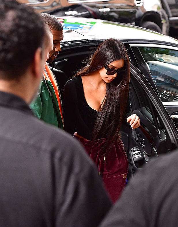 Kanye West and Kim Kardashian arrive to their Manhattan apartment after Kim was robbed in her Paris, France hotel room on October 3, 2016 in New York City. (Photo by James Devaney/GC Images)