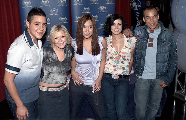 British pop stars (L-R) Noel Sullivan, Suzanne Shaw, Myleene Klass, Kym Marsh and Danny Foster of the pop group 'Hear'Say' attend a photocall at Madame Tussaud's Rock Circus to promote their new single 'Way To Your Love' on May 20, 2001 in London. (Photo by Dave Hogan/Getty Images)