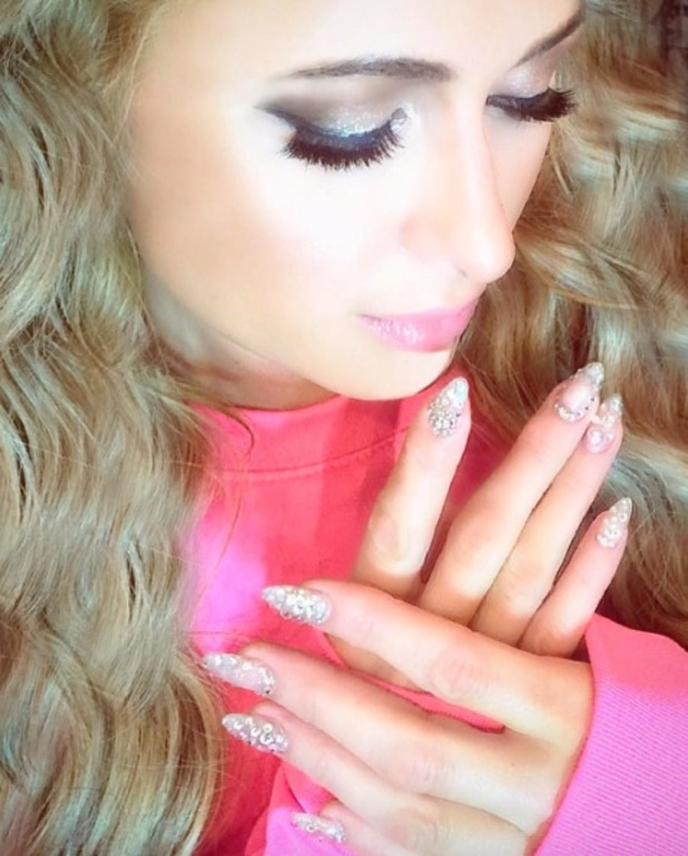 Paris Hilton shows off her embellished 'diamond' nails by celebrity nail artist, Xuan Bui, Nail Bandit, LA, 26 October 2016