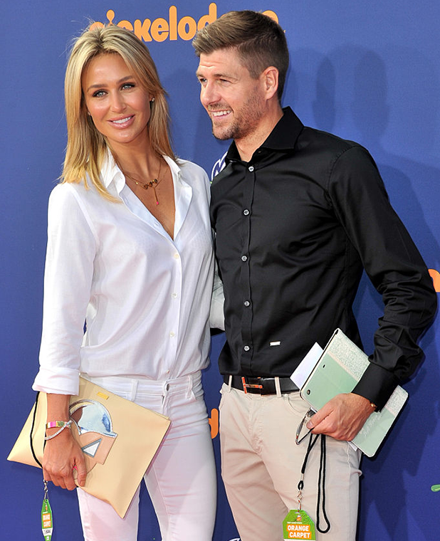 Steven Gerrard (R) and wife model Alex Curran attend the Nickelodeon Kids' Choice Sports Awards 2015 at UCLA's Pauley Pavilion on July 16, 2015 in Westwood, California. (Photo by Allen Berezovsky/WireImage)