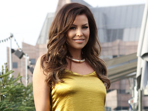 Former TOWIE star Jessica Wright braves cold in tiny gold dress at Manuka Doctor launch