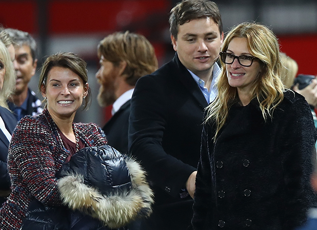 Actress Julia Roberts (R) talks with Coleen Rooney after the Premier League match between Manchester United and West Ham United at Old Trafford on November 27, 2016 in Manchester, England. (Photo by Clive Brunskill/Getty Images)